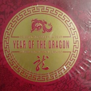 unopened Lunar Year of the Dragon stamps etc